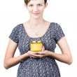 Stock Photo: Holistic naturopath holding jar of homemade spread