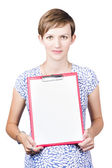 Young woman displaying a blank clipboard — Foto Stock