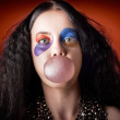 Jester girl blowing bubblegum ball — Stock Photo