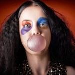 Jester girl blowing bubblegum ball — Stock Photo