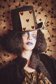 Vintage jester woman wearing the card of hearts — Stock Photo