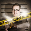 Stock Photo: Corrupt business man behind crime scene tape