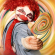 Hospital clown offering psychedelic lolly hypnosis — Stock Photo