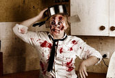 Funny zombie cook dancing in horror kitchen — Stock Photo