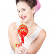 Sweet lolly shop lady offering over red lollipop — Stock Photo