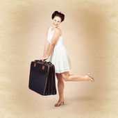 Vintage travel female holding old fashion suitcase — Stock Photo