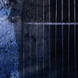 Old dark cave with blue light and a rusted iron gate  — Stock Photo