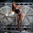 Sexy woman in lingerie on a stage with huge turbo wind fan behin — Stock Photo