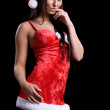 Very sexy christmas woman with red santa look on black backgroun — Stock Photo