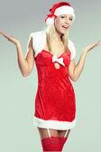 Mooie sexy vrouw Kerstmis of santa zoeken — Stockfoto