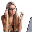 Beautiful womworks as secretary with headphone and laptop — Stock Photo #16628399