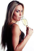 Beautiful woman in lingerie drinking champagne — Stock Photo