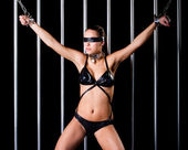 Bondage style with a sexy woman dressed in lingerie — Stock Photo