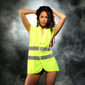 Sexy woman with safety jacket or vest and helmet — Stock Photo