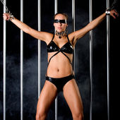 Beautiful woman in lingerie in bondage style — Stock Photo