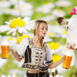 Sexy tiroler woman with a big glass of beer - Stock Photo