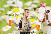 Sexy tiroler woman with a big glass of beer — Stock Photo