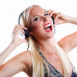 Woman listening to music on headphone — Stock Photo