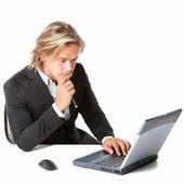 Beautiful man behind a laptop computer — Stock Photo
