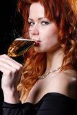 Glad kvinna med champagne — Stockfoto