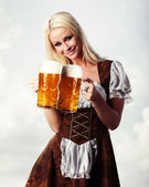 Woman in tiroler oktoberfest style with beer — Stock Photo