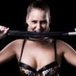 Beautiful woman with a whip — Stock Photo