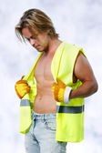 Beautiful and sexy man in construction outfit — Stock Photo