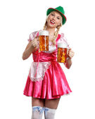 Woman in tiroler oktoberfest style with a glass of beer — Stock Photo