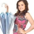 Stok fotoğraf: Attractive smiling girl in bright shirt holding beautiful blue