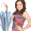 Стоковое фото: Attractive smiling girl in bright shirt holding beautiful blue