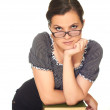 Attractive girl in a blouse and glasses stands leaning on a pile — Stock Photo