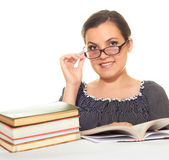 Attractive smiling girl in a black blouse with glasses reading a — Stock Photo