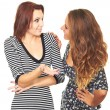 Two attractive smiling girl in a dress talking to each other. — Stock Photo