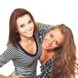 Постер, плакат: Two attractive smiling girls in dresses slightly bent forward