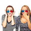 Royalty-Free Stock Photo: Two attractive girls surprised the 3D glasses.