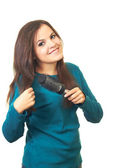 Attractive smiling girl with long dark hair in a blue blouse bru — Stock Photo