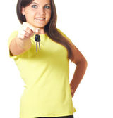 Attractive girl in a yellow shirt holding in her right hand keys — Stock Photo