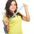 Attractive smiling girl in a yellow shirt holding a scissors in — Stock Photo