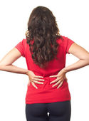 The girl in the red shirt is suffering from back pain. — Stock Photo