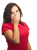 Attractive girl in a red shirt from the stench covers the nose. — Stock Photo