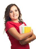 Attraktivt leende flicka i röd tröja håller en färgstark bok. — Stockfoto