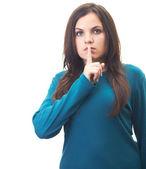 çekici genç kadın mavi gömlekli sessizlik belirtisi gösterir — Stok fotoğraf