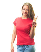 Attractive young woman in a red shirt shows her left hand, a sy — Stock Photo