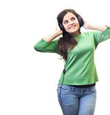 Attractive smiling young woman in a green shirt with headphones — Stock Photo
