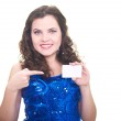 Attractive smiling young woman in a blue brilliant dress holding — Stock Photo #19428087