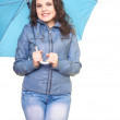 Attractive smiling young woman in a gray jacket was hidden from — Stock Photo #19428773