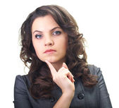 Attractive young woman in a gray business dress holding her fing — Foto de Stock