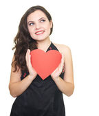 Happy young woman in black shirt holding red paper heart. — Stock Photo