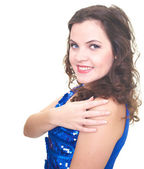 Attractive smiling young woman in a blue shiny dress hugs her ha — Stock Photo