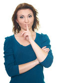 Attractive young woman in a blue shirt shows the sign of silence — Stock Photo